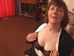 Attractive granny shows off hairy pussy