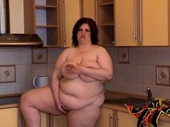 Fat Agatha is demonstrating her shaved pussy