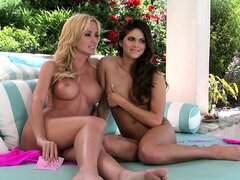 Two beautiful and sensuous girls with gorgeous bodies have fun together