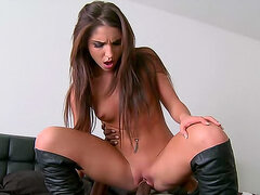 Shaved babe in leather boots fucked