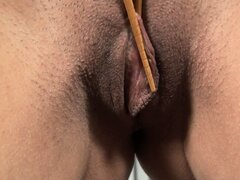 Kate spreads her thick pussy lips using a pair of chopsticks