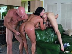 Johnny Sins squeezes his huge shaft into a hot brunette s ass