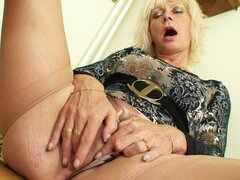 Stockings and garters on masturbating mature