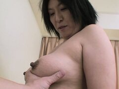 The Asian milf reveals her hot natural tits and pleases her hairy twat with a sex toy