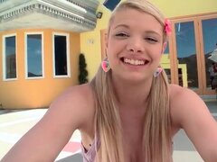 Adorable teen Stella Banxxx models outdoors