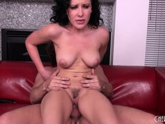Katie St. Ives takes her burly lover's huge cock down to the balls