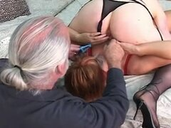 Slave worships mistresses pussy and mistress spanks slaves pussy with a paddle
