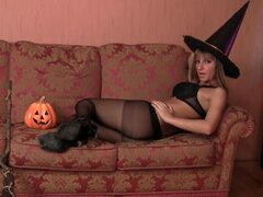 Sexy witch girl in black pantyhose solo