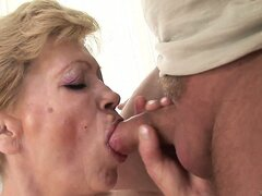 Horny grandma sucks a small stick and then gets banged from behind in her hairy pussy