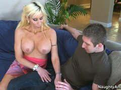 Stacked blonde cougar Morgan Ray has a passion for young guys with big shafts