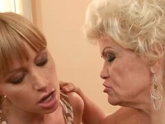 Effie has lesbian fun with a pretty blonde before riding some dude's cock