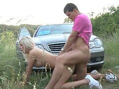 Guy Fucks Blonde Babe On His Car In The Country