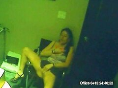 A chubby woman plays with a vibrator in the store room
