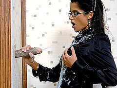 An office hottie gets covered in creamy jizz from a gloryhole groin ferret