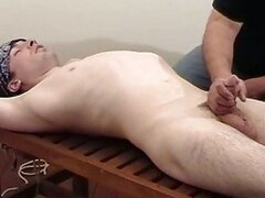 Daddy gives massage to cute son