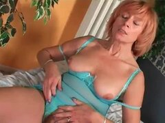 Dildo inside the mature pussy is sexy