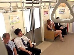 Cute Japanese girl gives a public handjob in a subway