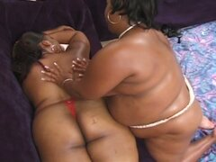 Fat ebony sluts sharing huge toy for nasty lesbian fun