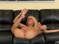 Horny Mikki Lynn fingers her twat and poses showing her stuff