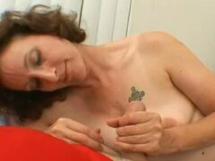 Mature brunette milf sucks and strokes cock