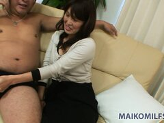 Hot Asian milf with a cute smile finds it hard to resist a young guy with a nice cock