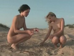 Naked girls walk the beach