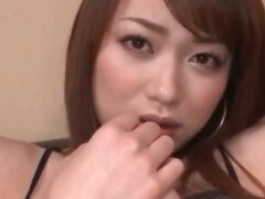 Close-up with asian redhead beauty sucking a dildo