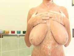 Beauty milf with huge breasts squizing...