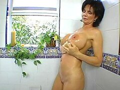Dark-haired mom gets her shaved pussy doggy style fucked