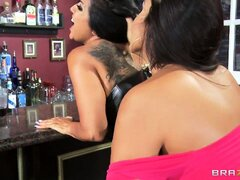 Slutty brunette with tattoos gets licked by her lesbian friend at the bar