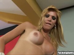 Kananda Hickmann jerks off her huge dong and later fucks her ass with a big red dildo.