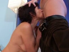 Brunette grandma gets younger dude to fuck her