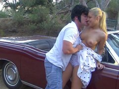 Blonde Hollie Stevens is sucking a dick in the car