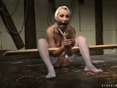She gets tied up naked in her stockings and gets gagged as well