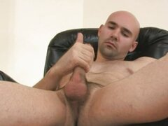 Bored bald poof jerking off on the sofa