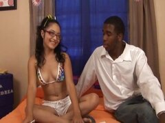Nerdy young Latina Andrea Kelly gets her mouth violated by a big black boner