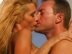 Jessica Drake gives blow job at fotoshooting