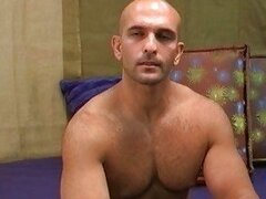 Bald gay hunk shows off his fully nude hot body