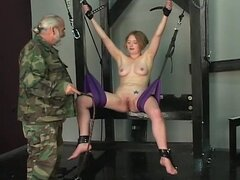 Cute tattooed young blonde has her pussy tortured while she rides sex swing