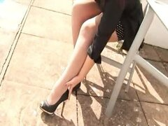 Loz Lorrimar in the outdoor office hose and heels