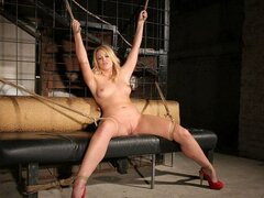 A chunky blonde chick has her hands and feet tied up so a fella can destroy her holes