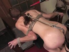 With a meat hook up her ass, a filthy slave gets a strap on stuffed inside her