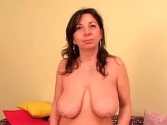 Mature babe shows her saggy tits on camera
