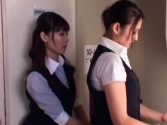 Sexy Asian business babes in skirts kiss