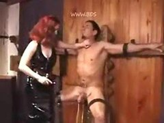 Redhead mistress makes sure he suffers