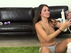 Allie Haze sucks on her big fake cock and gets her pussy wet