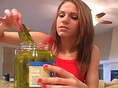 Bad teen tries to look horny playing with a pickled cucumber