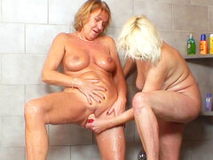 Two grannies are licking old pusses