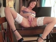Mature brunette housewife with big suckable tits.