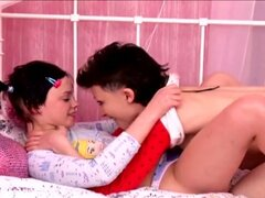 Teen lesbians Regina and Olga use a morning dildo to fuck
